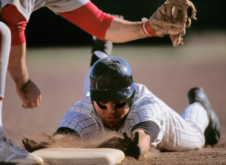 Baseball Player Sliding Into Base With Baseman Catching Ball --- Image By © Ocean/Corbis